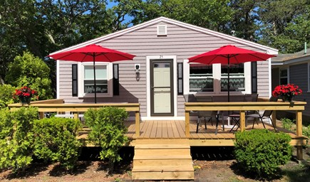 Dennisport Cape Cod vacation rental - Front view, spacious deck with picnic table and deck chairs