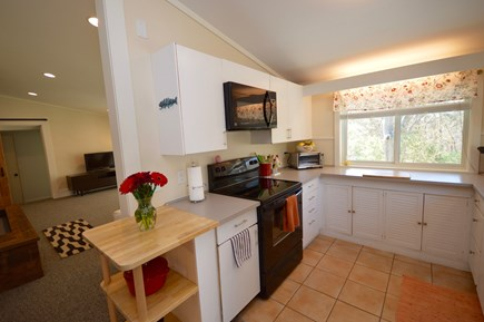 Orleans Cape Cod vacation rental - Kitchen leads to open dining/ living room- Wall of windows
