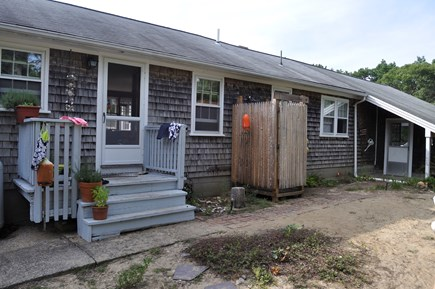North Eastham Cape Cod vacation rental - Rear entry of house with outdoor shower.  Pic table & furniture