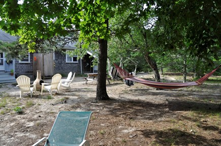 North Eastham Cape Cod vacation rental - Rear of house with plenty of seating and chiminea