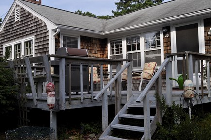North Eastham Cape Cod vacation rental - Front porch with sitting area and Weber Grill