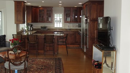 Hull MA vacation rental - TV room and kitchen.