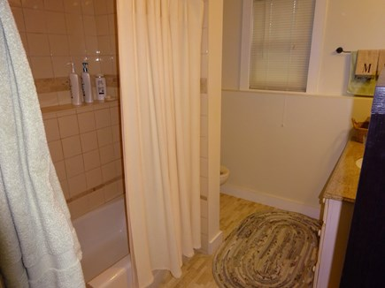 East Orleans Cape Cod vacation rental - Full bath with tub shower combo in lower level bedroom hallway.