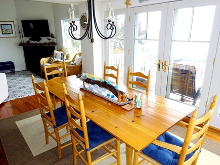 East Orleans Cape Cod vacation rental - Dining area with doors to back deck .