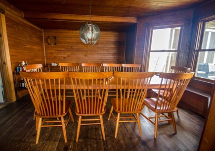 Truro Cape Cod vacation rental - Dining room with windows facing the ocean accommodate 8 guests.