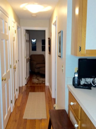 South Eastham 7 mins to Orlean Cape Cod vacation rental - First floor hall leading to guest bedroom, den and bathroom