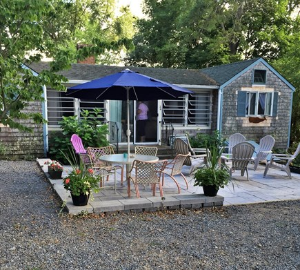 Pocasset, Wenaumet Bluffs Association Pocasset vacation rental - Patio with Fire Pit. Ideal for evening dining or socializing.