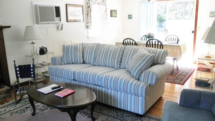 South Dennis Cape Cod vacation rental - Living room and dining room with slider to deck