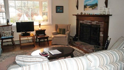 South Dennis Cape Cod vacation rental - Living room with working fireplace
