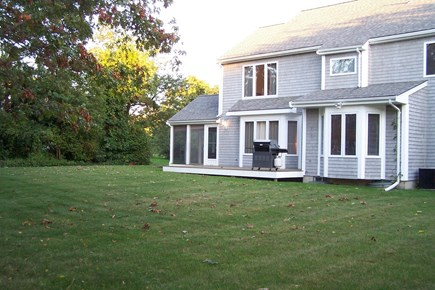 Brewster Cape Cod vacation rental - Level back yard is great for playing