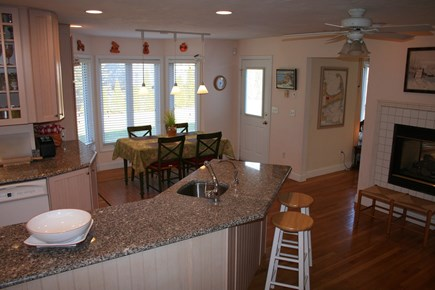 Brewster Cape Cod vacation rental - Breakfast nook with fireplace