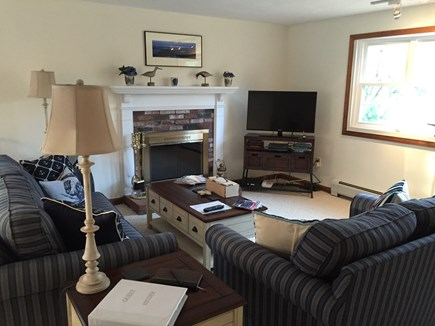 Harwich Cape Cod vacation rental - Living Room with TV and fireplace