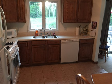 Harwich Cape Cod vacation rental - Kitchen w/dishwasher & views to the private back yard
