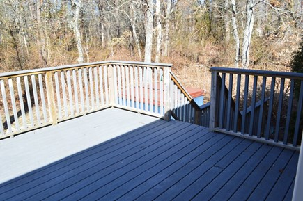 Dennis Cape Cod vacation rental - Large deck with table and chairs.