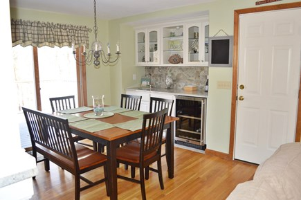 Dennis Cape Cod vacation rental - Dining Area with wet bar and glass slider to large composite deck