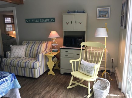 South Yarmouth Cape Cod vacation rental - More seating, microwave in cabinet