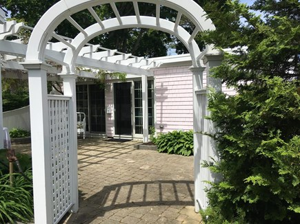 South Yarmouth Cape Cod vacation rental - Front of cottage through wisteria covered pergola