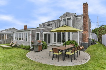 Barnstable Cape Cod vacation rental - Outdoor dining area with seating for 8 and a BBQ grill
