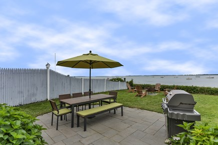 Barnstable Cape Cod vacation rental - View of the outdoor dining area from the house.