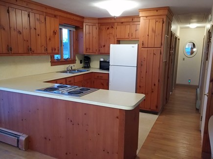 Brewster Cape Cod vacation rental - Kitchen and hallway to upstairs bedrooms