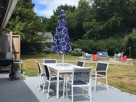 East Dennis Sesuit Neck Cape Cod vacation rental - Back of house, patio table, grill , fire pit &  outdoor shower!!!