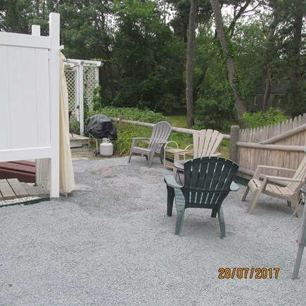 West Dennis Cape Cod vacation rental - Relaxing back yard with grill, fire pit and outdoor shower