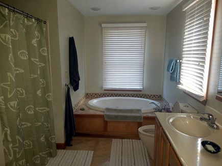 Wellfleet Cape Cod vacation rental - Master bathroom with Jacuzzi tub two sinks and shower