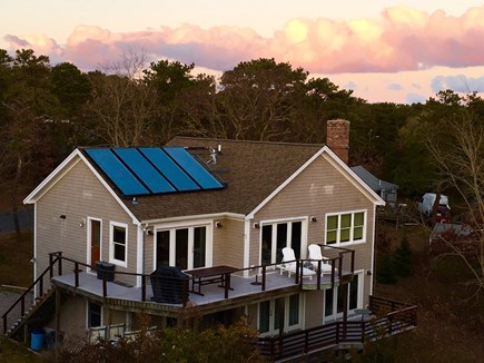 Wellfleet Cape Cod vacation rental - Rear view of house, large decks upper/lower, French doors