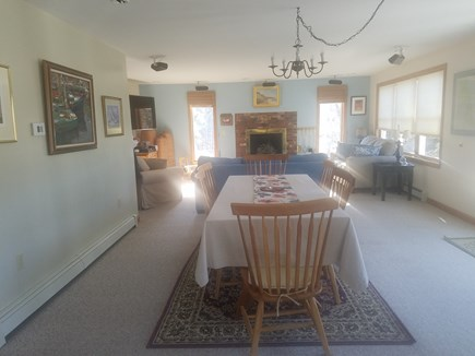 Wellfleet Cape Cod vacation rental - DR and LR with fireplace, 55 inch flat screen and surround sound.
