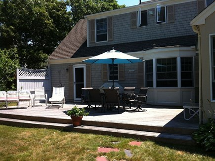 Falmouth Cape Cod vacation rental - Rear deck with dining for 6 and outdoor  seating.