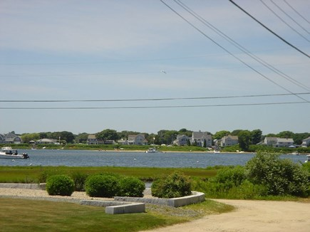 Falmouth Cape Cod vacation rental - View of Great Pond from the deck and back yard