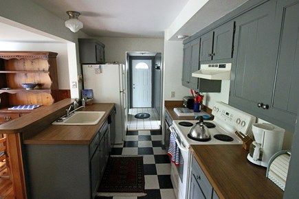 West Harwich Cape Cod vacation rental - Enter the kitchen area open to dining