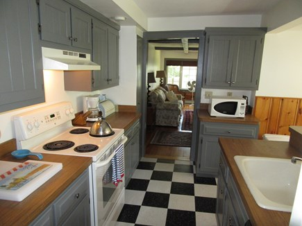 West Harwich Cape Cod vacation rental - Kitchen with living room beyond (dining is to the right)