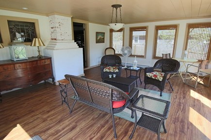 West Harwich Cape Cod vacation rental - Partial view of spacious sun room with door to patio & yard