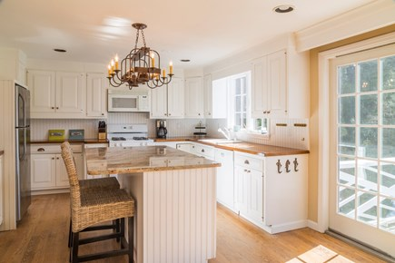 Chatham Cape Cod vacation rental - Kitchen with slider to the back deck
