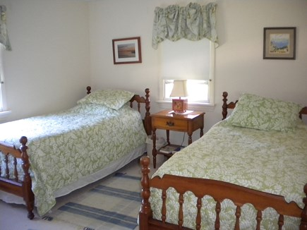 Harwich Port Cape Cod vacation rental - A bedroom with two beds, dresser and closet