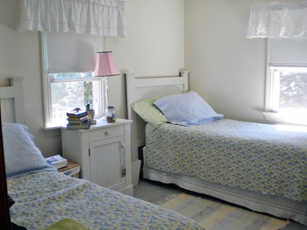 Harwich Port Cape Cod vacation rental - A bedroom with two beds, dresser, large night table and closet