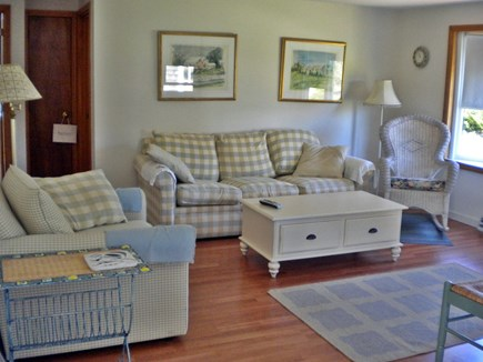 Harwich Port Cape Cod vacation rental - The sunny green living room with TV