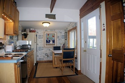 Wellfleet Cape Cod vacation rental - Kitchen with electric stove and door to back deck.