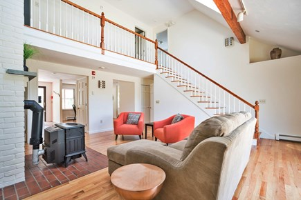East Dennis/Brewster line Cape Cod vacation rental - Living room (sleeper sofa) - sliders to deck and outdoor shower