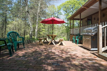 East Dennis/Brewster line Cape Cod vacation rental - Side patio with gas grill