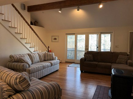 East Dennis/Brewster line Cape Cod vacation rental - Comfortable, open living room with sliders to deck.