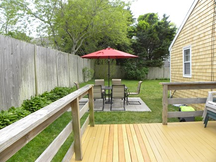 Hyannis Cape Cod vacation rental - Deck and patio with outdoor dining set.