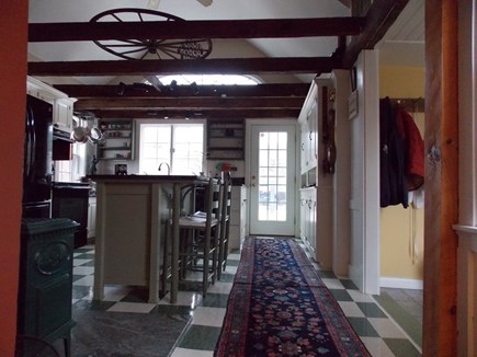 Brewster Cape Cod vacation rental - Kitchen looking at front door Entry with mud room/bathrm on right