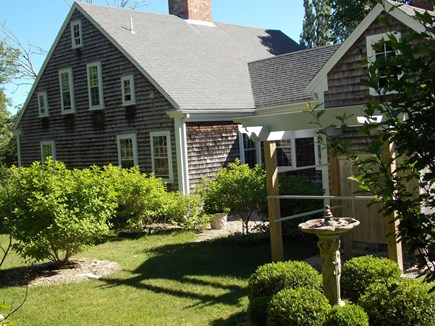 Brewster, Lower Cape, Located  Cape Cod vacation rental - Outdoor shower - a summer favorite looking over Hydrangea garden