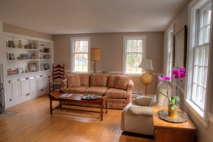 Orleans Cape Cod vacation rental - A spacious living room downstairs with a TV for family movies.