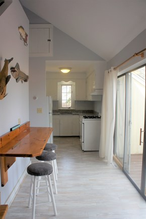 West Yarmouth Cape Cod vacation rental - Bar, sliding glass doors and kitchen