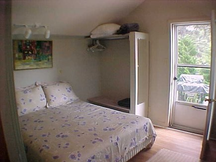Dennis Port Cape Cod vacation rental - Bedroom - Queen Size Bed, Back Door to Outdoor Patio & Grill