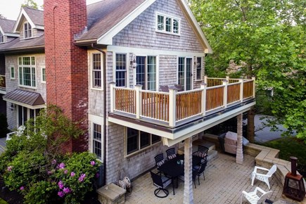 Falmouth Cape Cod vacation rental - Enjoy outdoor dining & cooking on the gas grill in the backyard