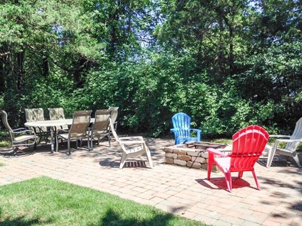 Dennis Cape Cod vacation rental - Gas grill & seating for summer barbecues outside on the patio